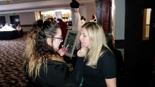 model getting make up applied