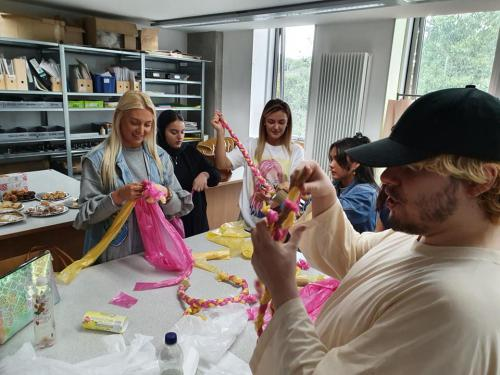 Fashion students plaiting coloured bin bags