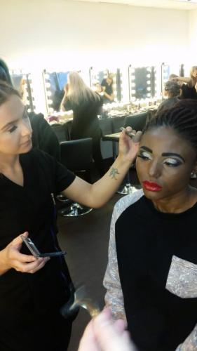 Model getting face powder applied