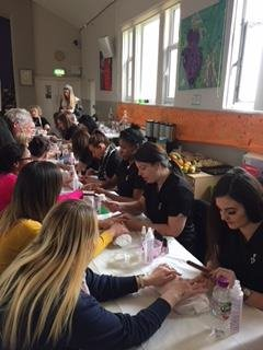Beauty students doing manicures