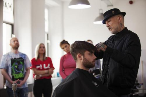 Alan demonstrating hair cutting