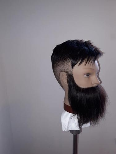 Dummy head with hair styled
