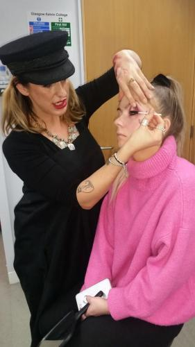 make up artist applying eye make up