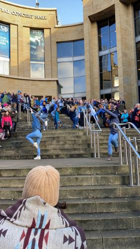 students performing on stairs