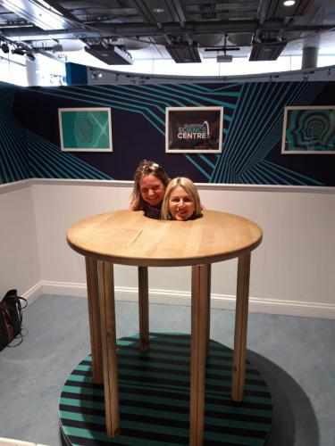 Optical illusion with students heads on table