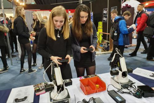 students working robotic arms