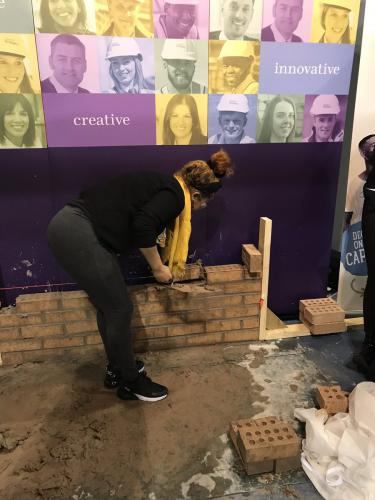 beauty student trying bricklaying