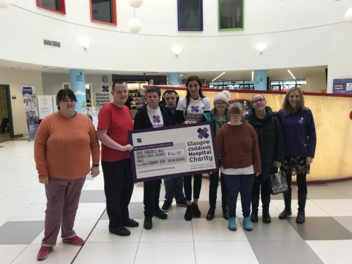 Skills for Learning Fundraising team with cheque