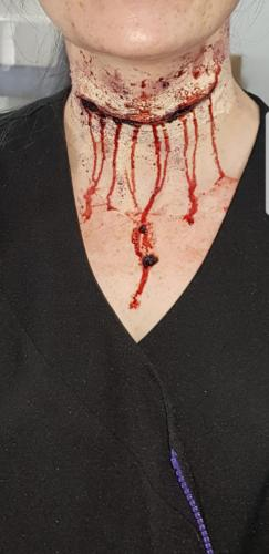 fake wound to throat