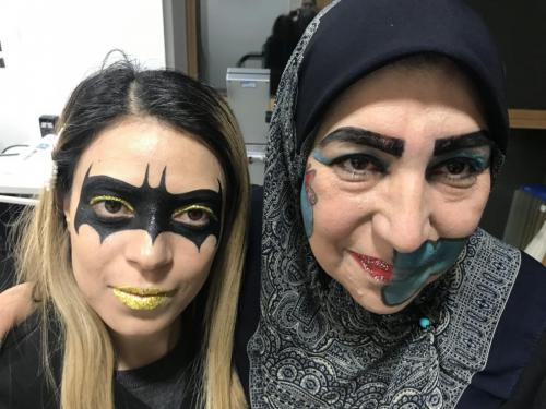 students with batgirl and witch make up