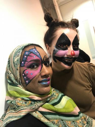 students with butterfly and cat make up