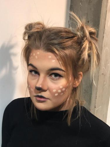 students with leopard make up