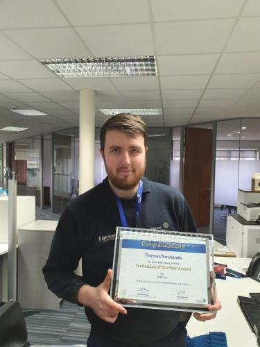 Picture of Thomas Newlands with certificate