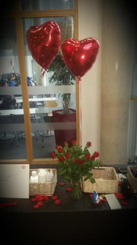 Heart shaped balloons and candles