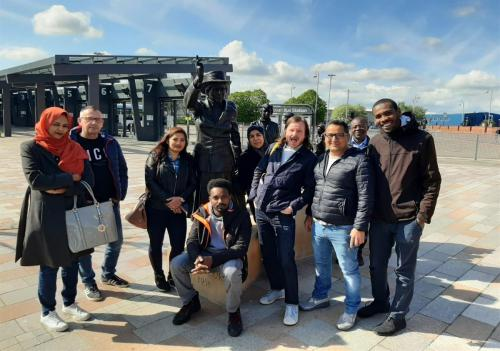 Group shot of students visiting the Mary Barbour Statue