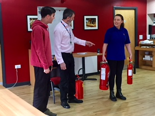 student with fire extinguishers