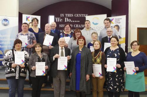 Group shot of community learners with awards