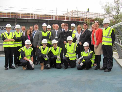The talented pupils on site with representatives from Morgan Sindall, hubWest, staff from Glasgow Kelvin College and Cllr Eric Gotts, Convenor of Education at East Dunbartonshire Council