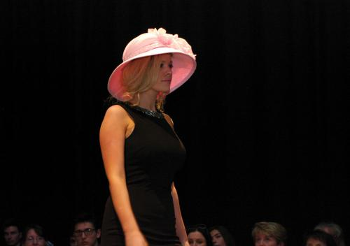 Millinery student in pink hat