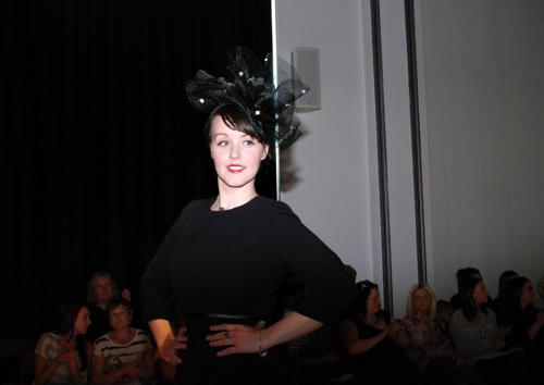 Millinery model in netted hat
