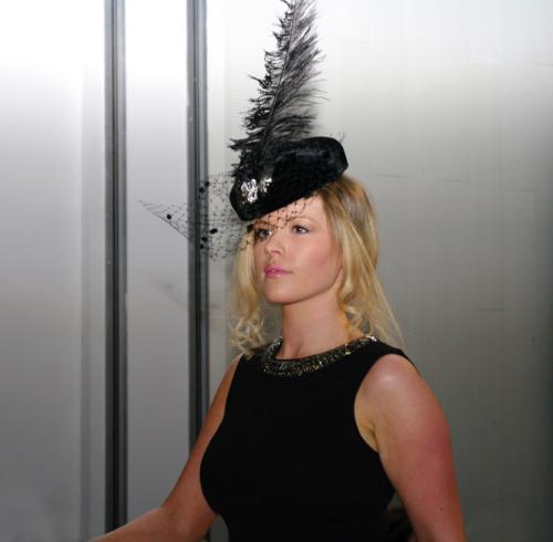 Millinery model in feathered hat