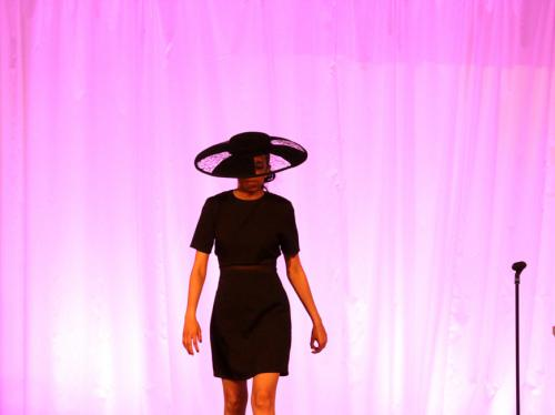 Millinery model with large hat