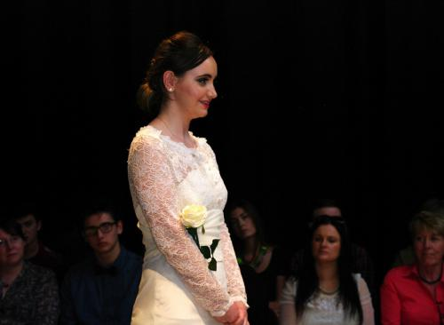 Model in long sleeved wedding dress