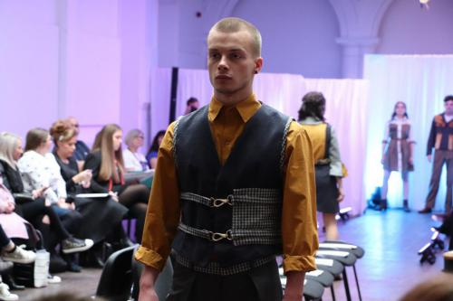 Male model in black and mustard outfit