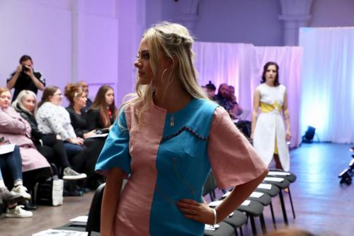 Model in pink and blue dress