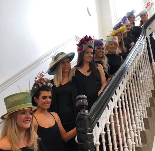 All hat models standing on stairs