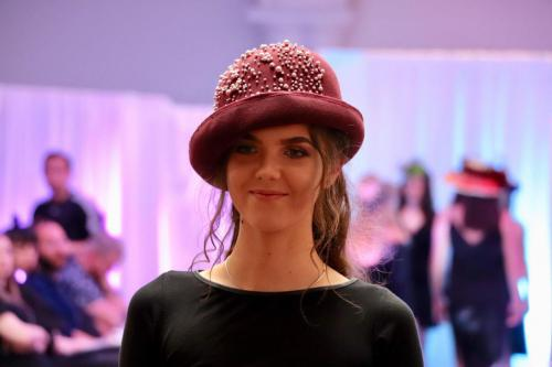 Model in rose hat with pearls