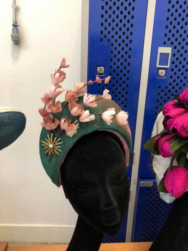 Green hat with flowers on head dummy