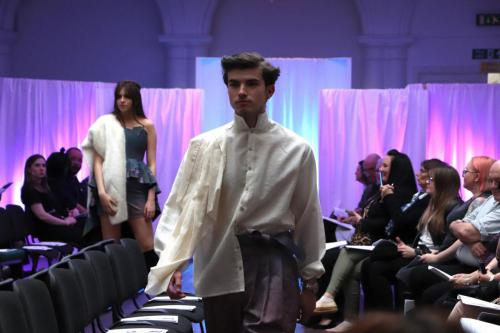 Male model in white shirt and trousers