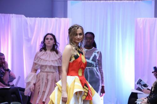 Three models on catwalk in different outfits