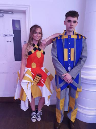 Male and female models in bright coloured outfits