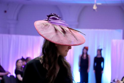 Model in large pink flat hat