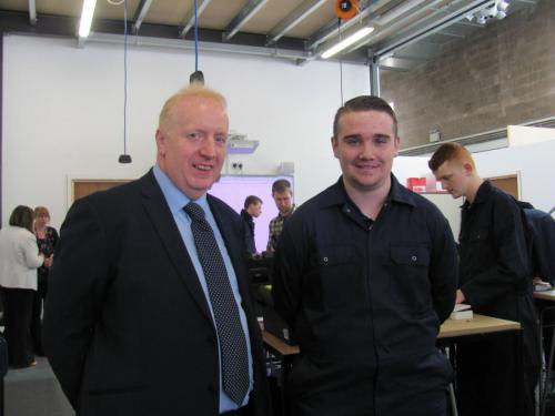 A delighted Frazer is pictured here with Gerry McCarron in one of the College's engineering workshops at its Springburn campus.