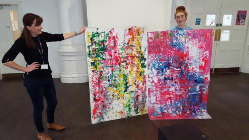 Student with abstract painting