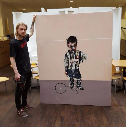 Student with painting of footballer