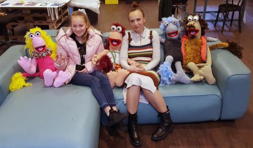 Student with daughter and handmade puppets