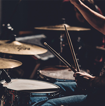 someone playing the drums