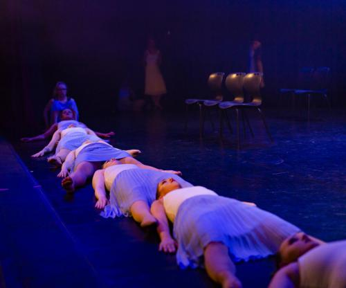 Dancers lying on stage