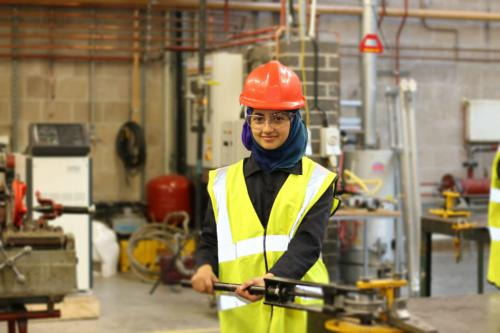 Female in construction outfit and hard hat