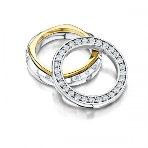 three rings in white and yellow gold with stones