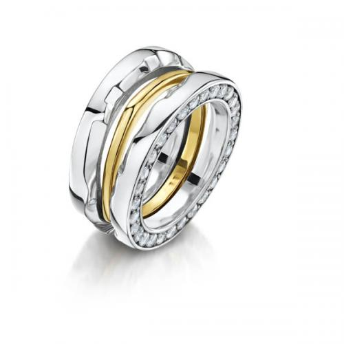 three rings in white and yellow gold with stones fitting together