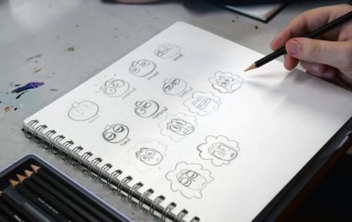 Sketches of cartoon faces on pad