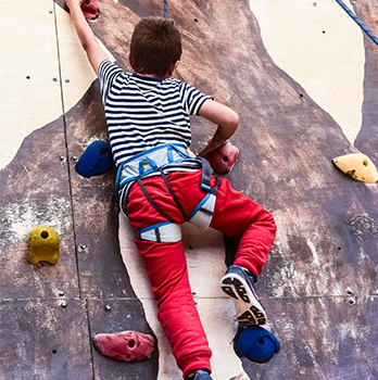 Boy using a climbing wall