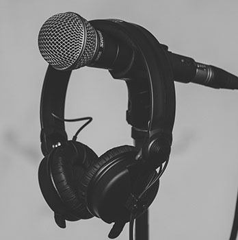 Headphones hanging on a microphone
