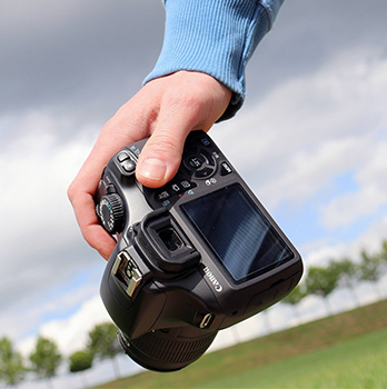 camera in persons hand
