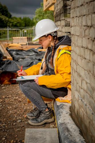 Female Construction worker filling in form